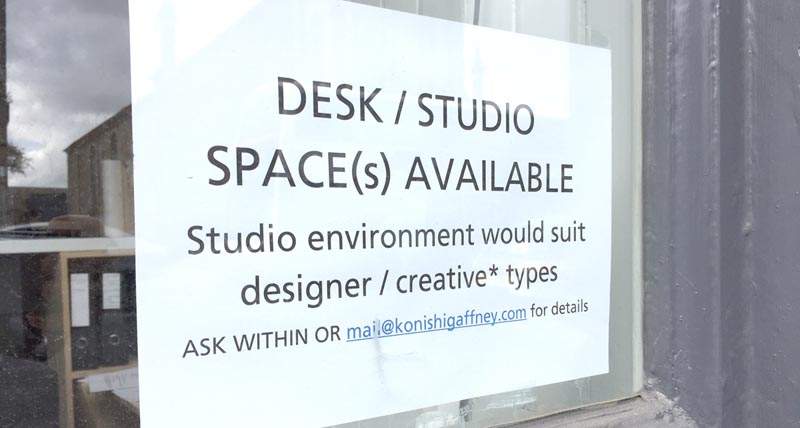 Desk space available sign